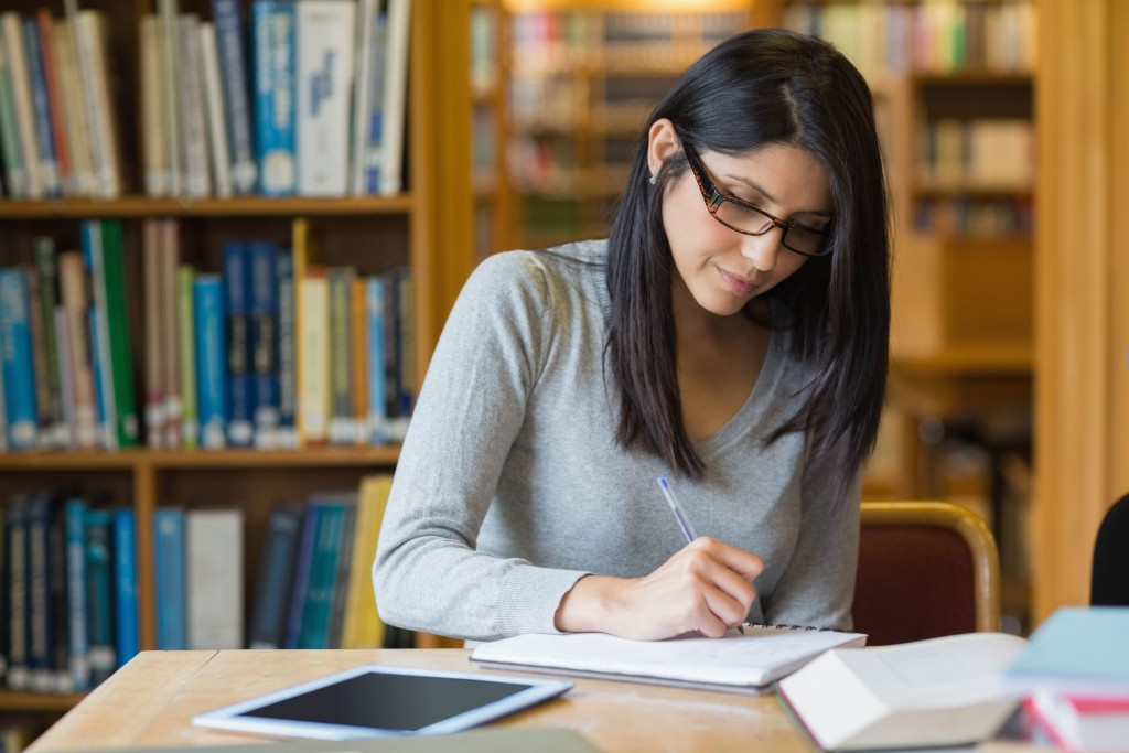 15593460 - black-haired woman studying in the library